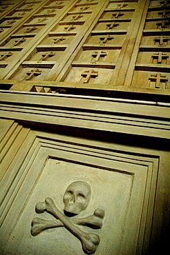 Salvador de Bahia, Bahia, Brazil, skull and bones on relief in the charnel house of the Igreja da Ordem Terceira Secular de Sao Francisco da Bahia