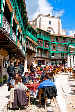 People sitting on terraces at the Main Square. Chinchon, Madrid province, Spain.