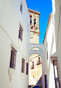 Street and church of Santa Maria. Arcos de la Frontera, Cadiz province, Andalucia, Spain.