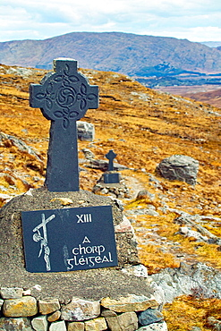 Stone crosses, marking the stations of the cross at Maumeen pass, Maamturk Mountains, County Galway, Ireland. Every year pilgrims climb to this location for mass and stations of the cross, celebrated here.