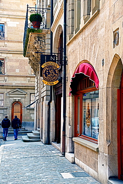 As jewelry and the watch capital of the world Geneva has always attracted some of the wealthiest tourists in the world, here Christieís, famous action house, saleroom in Geneva, Place de la Taconnerie, old town, Geneva, Switzerland