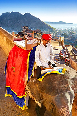 Portrait of indian mahout man and his elephant, Amber Fort, Jaipur, Rajasthan, India.