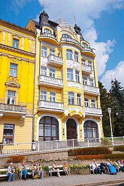 People sitting at Mirove namesti square Marianske Lazne aka Marienbad spa town Karlovy vary region Czech Republic Europe.