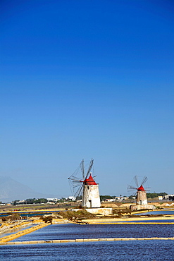 Windmills at Salt Pans in Trapani, Sicily, Italy.
