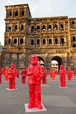 sculptures of Karl Marx in front of the Porta Nigra, installation by the artist Ottmar Horl, Trier, Germany.