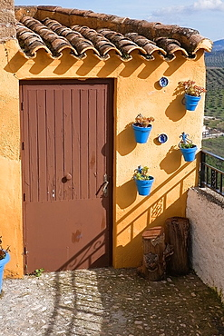 Traditional Andalusian townhouse decorated with flower pots, Iznajar, Cordoba province, Andalucia, Spain.