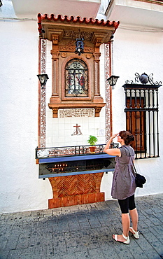 Woman praying in the altar of the Cirsto de la Providencia, Andujar, Jaen province, Andalusia, Spain