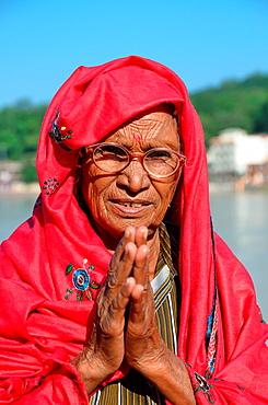 Pilgrim woman in the Ganges River, Rishikesh, India.