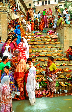 women ritual were fruit is offered to the Gods in the Ganges in Varanasi, India