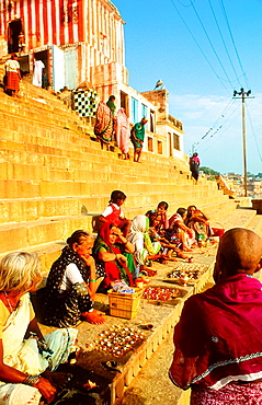 women having rituals at the ghats in Varanasi, India