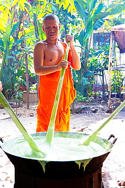 Monks prepare a coconut sweet dessert for a festival at Pha That Luang Temple in Vientaine, Laos.