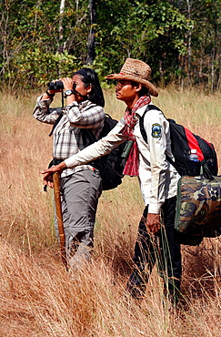 Tour guide leading a group of tourists. Dey Ei Trek to the O Chbar river. Mondulkiri, Cambodia.