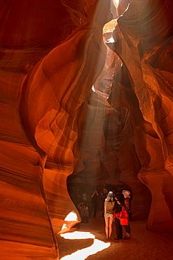 tourists marveling at Upper Antelope Canyon, Page, Arizona.