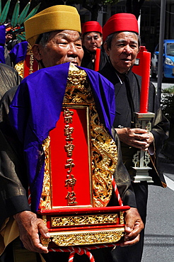 Naha, Okinawa, Japan, a man carrying a Chinese ëspirits tableí during the inauguration of a new Confucian temple in Matsuyama neighborhood