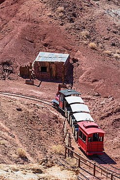 Historic train driving through the valley in Calico Ghost Town, California, USA