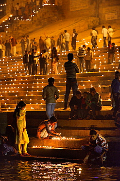 India, Uttar Pradesh, Varanasi, Dev Deepawali festival, Hindu devotees lighting oil lamps.
