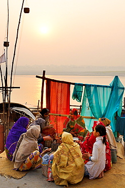 India, Uttar Pradesh, Varanasi, Guru and disciples at sunrise.