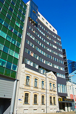 Old facade left behind new office blocks Tallinn city business district Estonia the Baltics Europe.