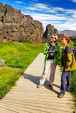 women in Rift Valley. Pingvellir National Park. Golden Circle. Iceland, Europe.