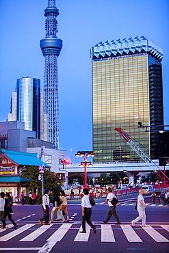 Crosswalk in Kaminarimon street, in background Sky Tree, Asakusa District, Tokyo, Japan.