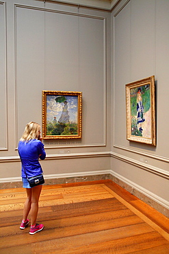 Girl in front of Manet's paintings, National Gallery of Art, Washington D.C., USA.