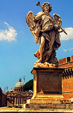 Angel Statue by Antonio Giorgetti, in Castel Sant Angelo bridge, Italy, Rome, Vatican City Saint Peter's basilica in background.