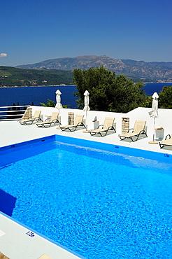 Swimming pool at Scorpios Apartments near Samos Town, Samos Island, Greece.