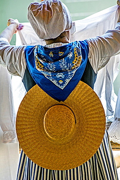 Europe, France, Alpes-de-Haute-Provence (04), Valensole. Washerwoman in traditional Provencal costume.