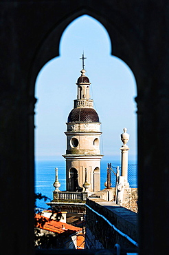 Europe, France, Alpes-Maritimes, Menton. The bell tower of white penitents chapel view from the Vieux Chateau cemetery.