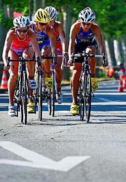 four female athletes, biking race, 25th International Geneva Triathlon, on July 21, 2013, Quai du Mont-Blanc, Geneva, Switzerland