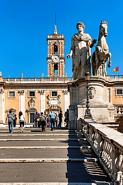 By Michelangelo designed ramp stairs cordonata to the Piazza del Campidoglio. At the end of the stairs there are statues of Castor and Pollux. In the background is the Senatorial Palace Palazzo Senatorio, Rome, Lazio, Italy, Europe.