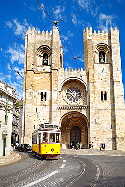 Tram 28 and Se Cathedral, Alfama district, Lisbon, Portugal.