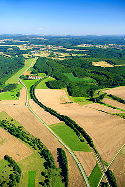 Aerial view of Heiligenbronn farm and forest on road between Enchenberg and Gros Rederching, Moselle, Lorraine, France, Natural regional park of Northern Vosges