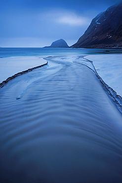 River flows through Haukland Beach, Vestvagoy, Lofoten Islands, Norway.