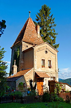 House built in the medieval tower of the walls of Sighisoara Saxon fortified medieval citadel, Transylvania, Romania.