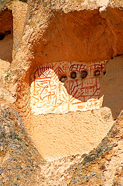 Traditional decorations outside the rock houses of Uchisar, Cappadocia Turkey.