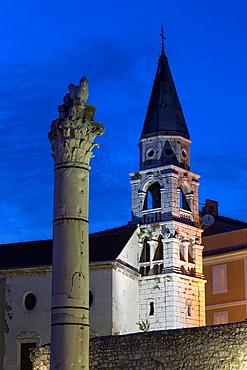 church and Roman column at night, Zadar, Croatia.
