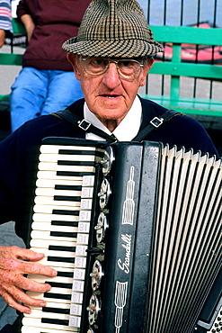 Man playing accordion in Cornwall England.