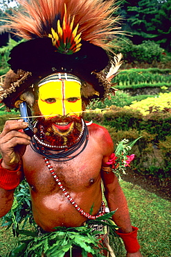 Colorful Huli Wigman of Papua New Guinea On Cell Phone.