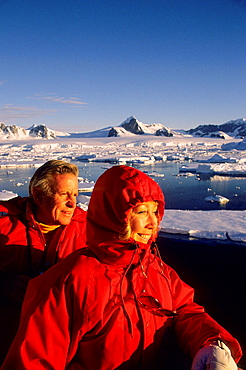 Antarctic Peninsula Area, Passengers On Deck Of Cruise Ship Viewing Landscapein Midnight Sunshine