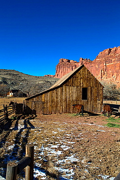 Horse stable and corral with sandstone rock formations in the background, Historic Fruita, Capitol Reef National Park, Utah, United States of America.