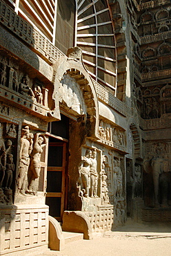 General-View of the facade, Lower showing Chaitya arch, Mithuna couple and Sanchi rail pattern at the bottom on either side of the Doorway. Karla Chaitya, Dist Pune, Maharashtra.