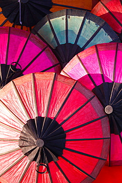 Sale of colorful Sun Shades on a Street Market in Luang Prabang, Laos