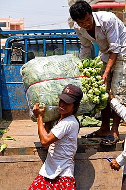 Unloading Vegtables Truck on a Market in Phnom Penh, Cambodia.