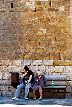 Man and old Woman on a Bench in Cole di Val d'Elsa in Tuscany, Italy.