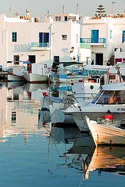Fishing boats at the harbor of Naoussa, Paros, Cyclades Islands, Greek Islands, Greece, Europe.