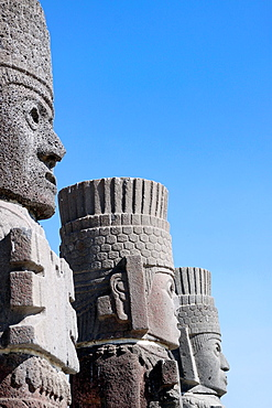 Statuary 10th century stone sculptures columns of Toltec warriors dressed in feathers and gods. Tula, Mexico.