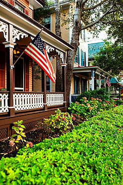 Cape May is America¥s first seaside resort. It has the largest collection of Victorian Architecture in the United States. Green boxwood hedge and american flag is distinctly a nostalgic image of early 20th Century small town America