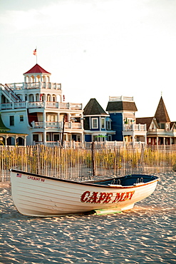 The Sea Mist is a 1873 historic Victorian home on Ocean Ave in Cape May and a life boat on the beach dune.