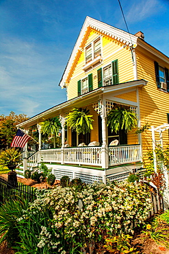 Cape May is America¥s first seaside resort. It has the largest collection of Victorian Architecture in the United States. A white railing on the porch and a american flag is a distinctly nostalgic image of early 20th Century small town America.